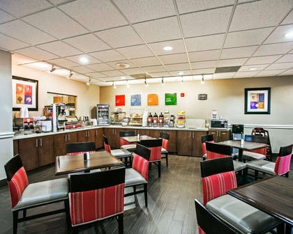 Enjoy breakfast in this seating area | Comfort Suites Willowbrook