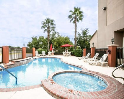 Relax in the hot tub | Comfort Suites Willowbrook