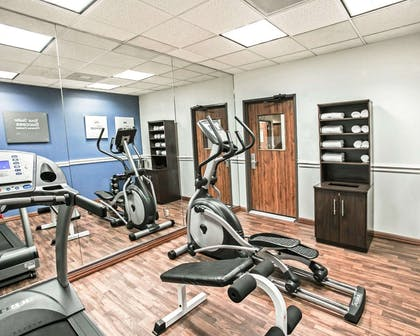 Fitness center with cardio equipment and weights | Comfort Suites Willowbrook