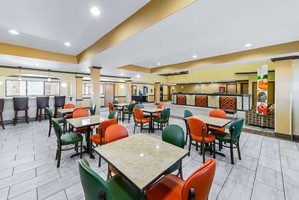 Enjoy breakfast in this seating area | Quality Inn & Suites