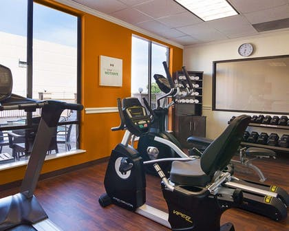 Fitness center with cardio equipment and weights   Comfort Suites Houston West at Clay Road