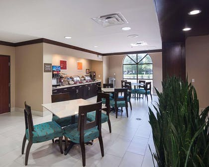 Enjoy breakfast in this spacious area   Comfort Suites Houston West at Clay Road