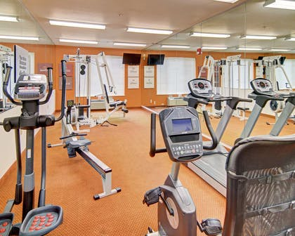 Exercise room with cardio equipment and weights | Comfort Suites Roanoke - Fort Worth North