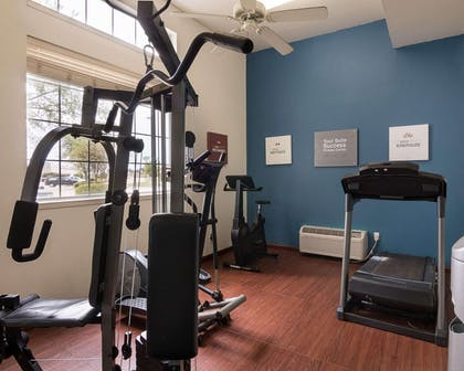 Fitness center with cardio equipment and weights | Comfort Suites Texarkana