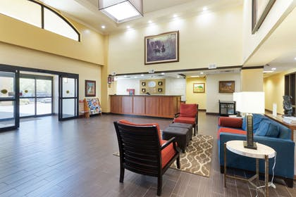 Spacious lobby with sitting area | Comfort Suites Austin Airport