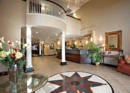 Front desk with friendly staff   Quality Inn & Suites, Near University
