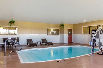 Relax by the pool | Comfort Suites Plainview