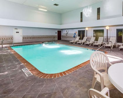 Indoor pool with hot tub   Quality Inn & Suites