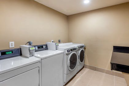 Guest laundry facilities | Quality Suites Sherman