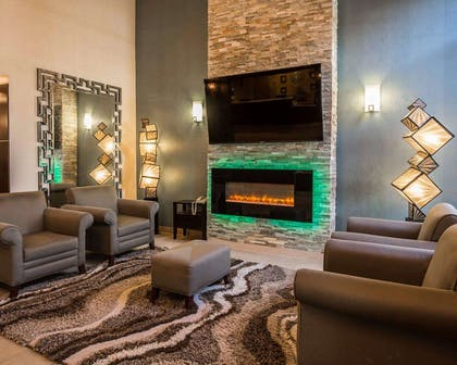 Lobby with fireplace | Comfort Suites Stafford Near Sugarland
