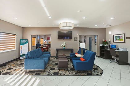 Spacious lobby with sitting area | Comfort Suites Lewisville
