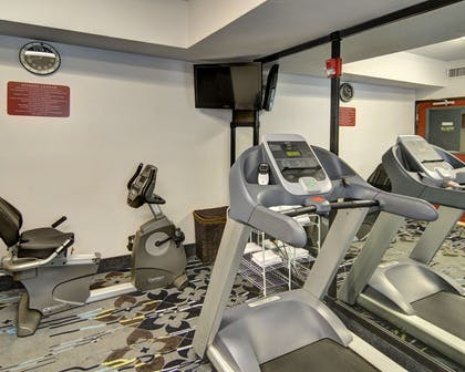 Exercise room with cardio equipment | Comfort Inn & Suites Beachfront