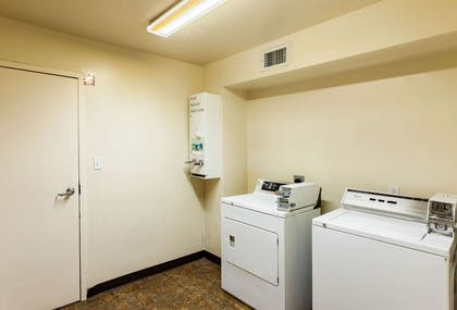 Guest laundry area | Quality Inn near SeaWorld - Lackland