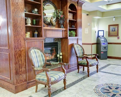 Spacious lobby with sitting area | Comfort Suites University Drive
