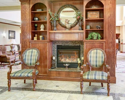 Lobby with fireplace | Comfort Suites University Drive