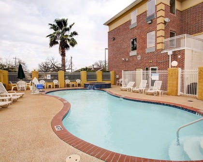 Outdoor pool with sundeck | Comfort Suites University Drive