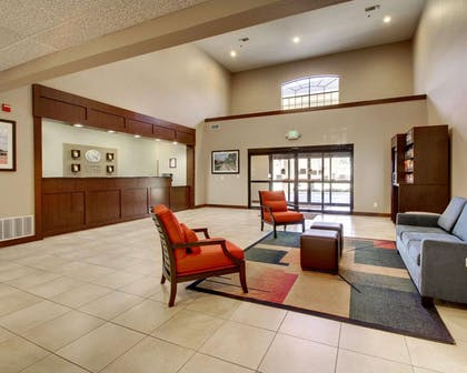 Spacious lobby with sitting area | Comfort Suites Tyler South