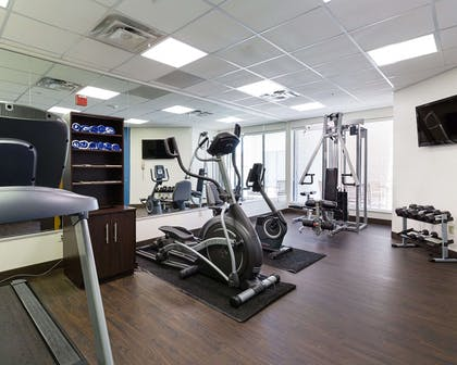 Exercise room with cardio equipment and weights | Comfort Suites Deer Park Pasadena