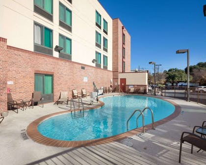 Outdoor pool | Comfort Inn And Suites Airport