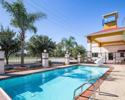 Outdoor pool with sundeck   Rodeway Inn & Suites Humble, TX