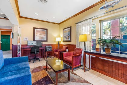 Lobby with sitting area | Quality Inn & Suites Beachfront