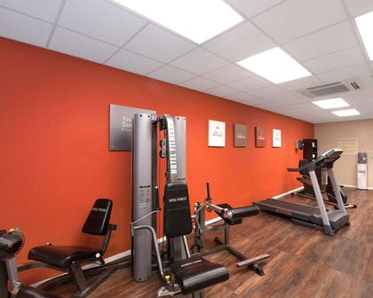 Fitness center with cardio equipment and weights | Comfort Suites University