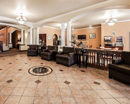 Spacious lobby with sitting area | Sleep Inn And Suites Shamrock