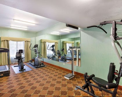 Fitness center with cardio equipment and weights | Comfort Inn and Suites Near Medical Center