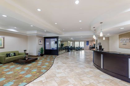 Spacious lobby with sitting area | Rodeway Inn & Suites