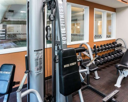 Exercise room with cardio equipment and weights   Comfort Suites Nacogdoches