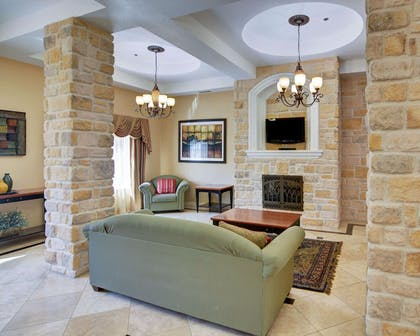 Spacious lobby with sitting area | Comfort Suites