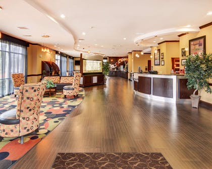 Spacious lobby with sitting area | Comfort Suites Kilgore
