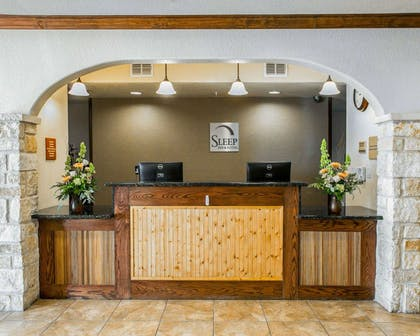 Front desk with friendly staff | Sleep Inn & Suites near Palmetto State Park