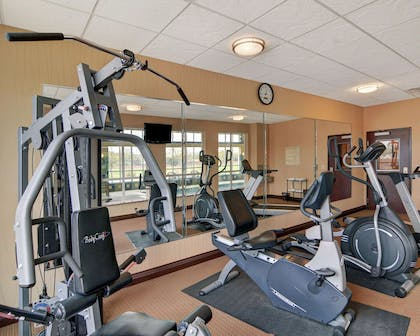 Exercise room with cardio equipment and weights | Comfort Inn & Suites Near Lake Lewisville