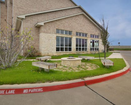 Firepit available outside with bench style seating | Comfort Inn & Suites Near Lake Lewisville
