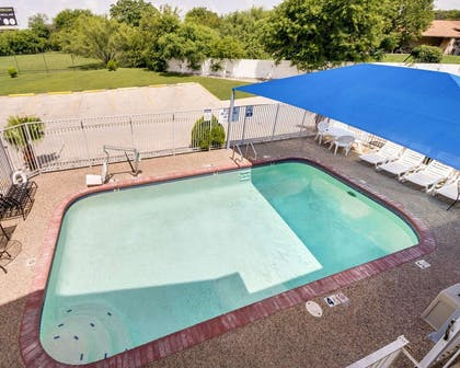 Outdoor pool with sundeck | Econo Lodge Inn & Suites Downtown Northeast