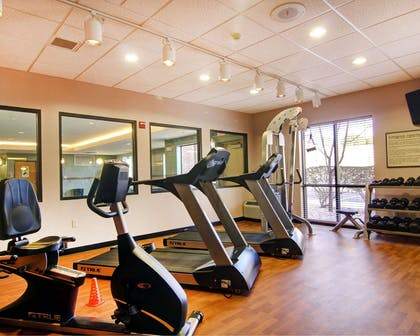 Exercise room with cardio equipment and weights | Comfort Suites El Paso West