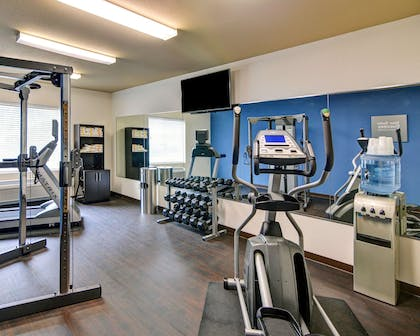 Exercise room with cardio equipment and weights | Comfort Suites Arlington - Entertainment District