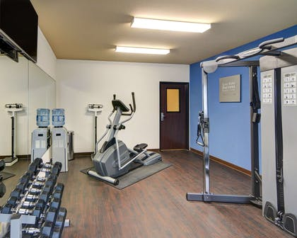 Fitness center with cardio equipment and weights | Comfort Suites Arlington - Entertainment District