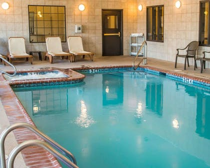 Indoor pool with lounge area | Sleep Inn & Suites at Six Flags