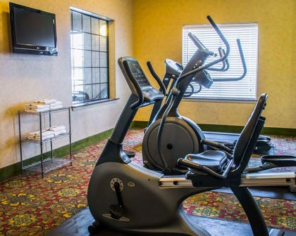 Fitness center with television | Sleep Inn & Suites at Six Flags