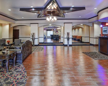 Spacious lobby with sitting area | Comfort Suites At Lake Worth