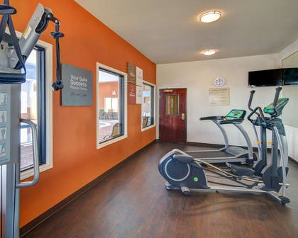 Exercise room with cardio equipment and weights | Comfort Suites At Lake Worth
