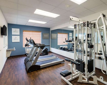 Exercise room with cardio equipment and weights | Comfort Suites