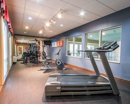 Fitness center with cardio equipment and weights | Comfort Suites Pecos