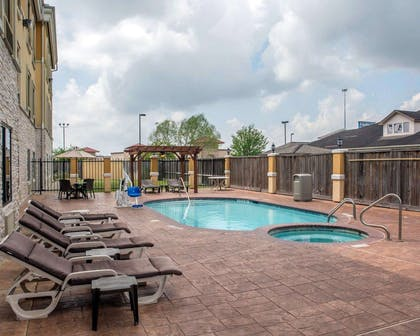 Outdoor pool with sundeck | Sleep Inn And Suites Pearland - Houston South