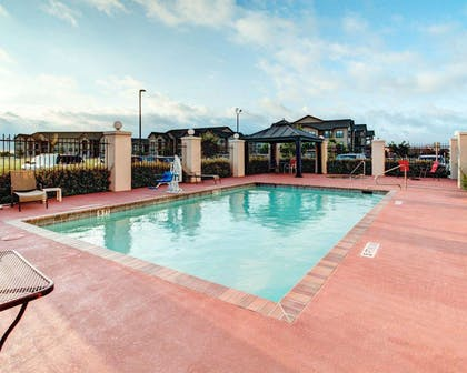 Outdoor pool with sundeck | Comfort Suites Waxahachie - Dallas