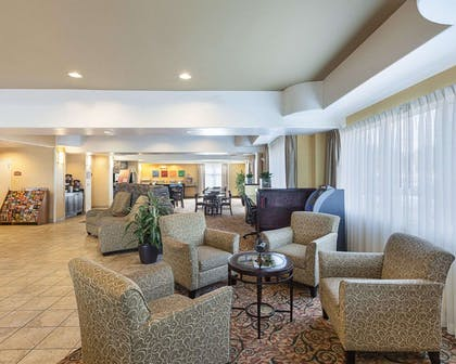 Spacious lobby with sitting area | Comfort Suites Medical Center near Six Flags