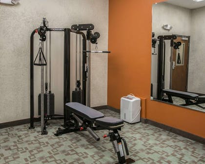 Fitness center with cardio equipment and weights | Sleep Inn & Suites Highway 290/NW Freeway