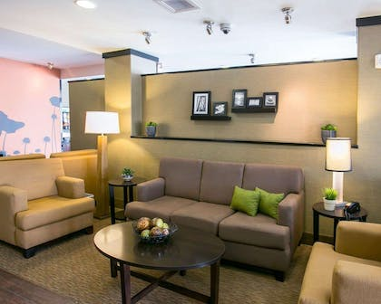 Spacious lobby with sitting area | Sleep Inn & Suites Austin Northeast